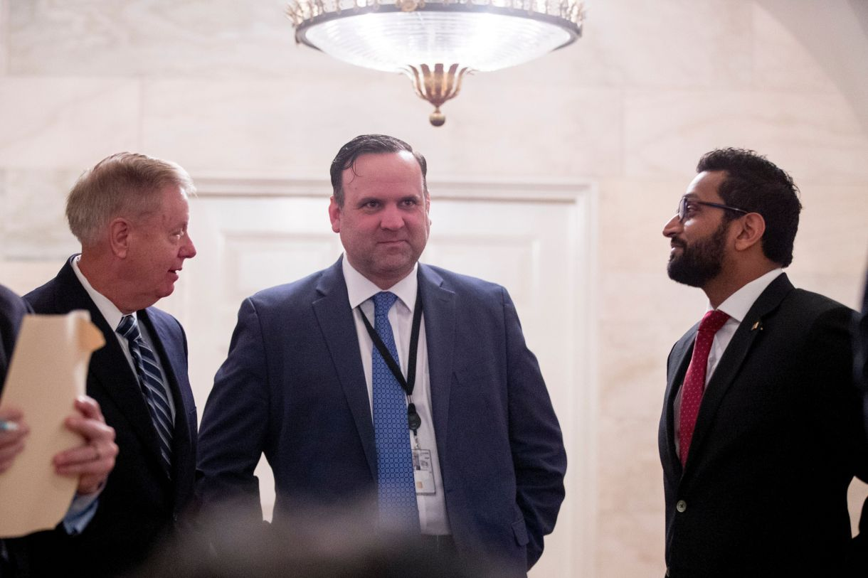 From left, Sen. Lindsey Graham (R-S.C.), White House social media director Dan Scavino, and National Security Council Senior