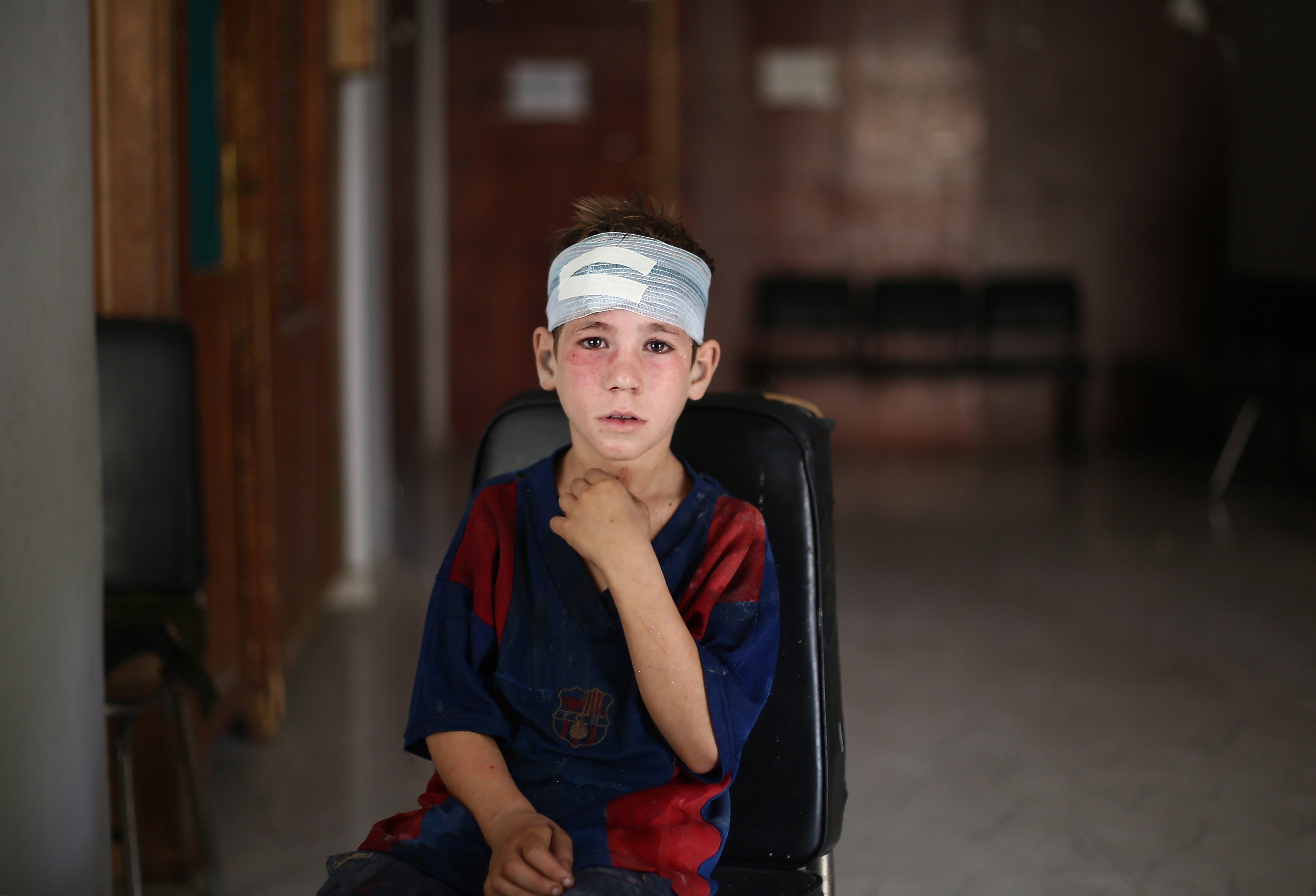 """<span class='image-component__caption' itemprop=""""caption"""">A child receives medical treatment after Syrian regime forces staged an airstrike in Damascus on Sept. 11, 2015.</span>"""