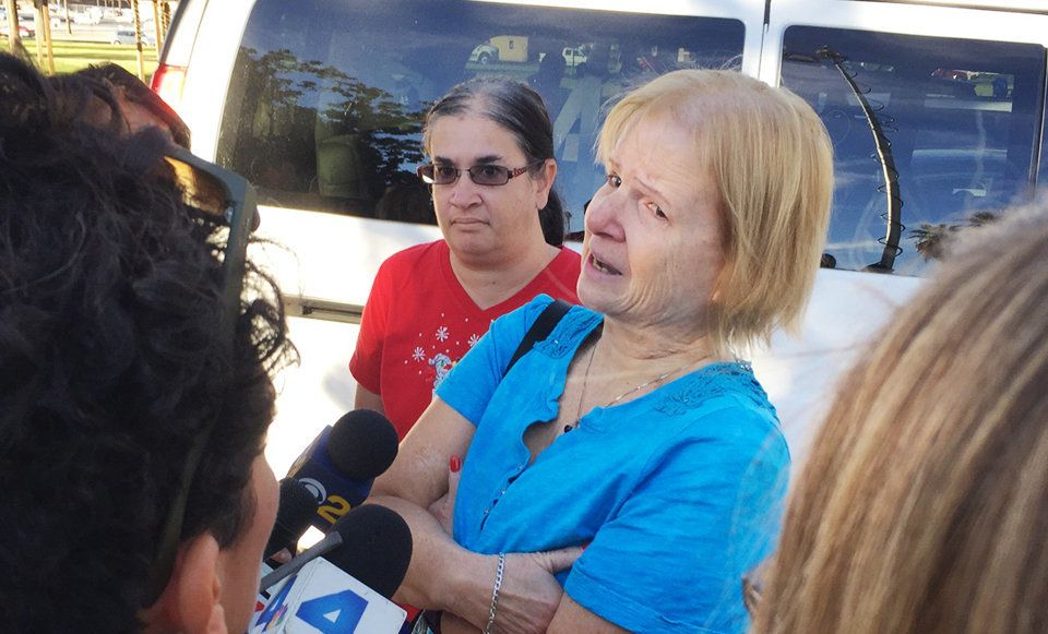 """<span class='image-component__caption' itemprop=""""caption"""">Sherry Esquerra with daughter Angel (in red) speaks to reporters near the shooting scene in San Bernardino, California, onWednesday.</span>"""