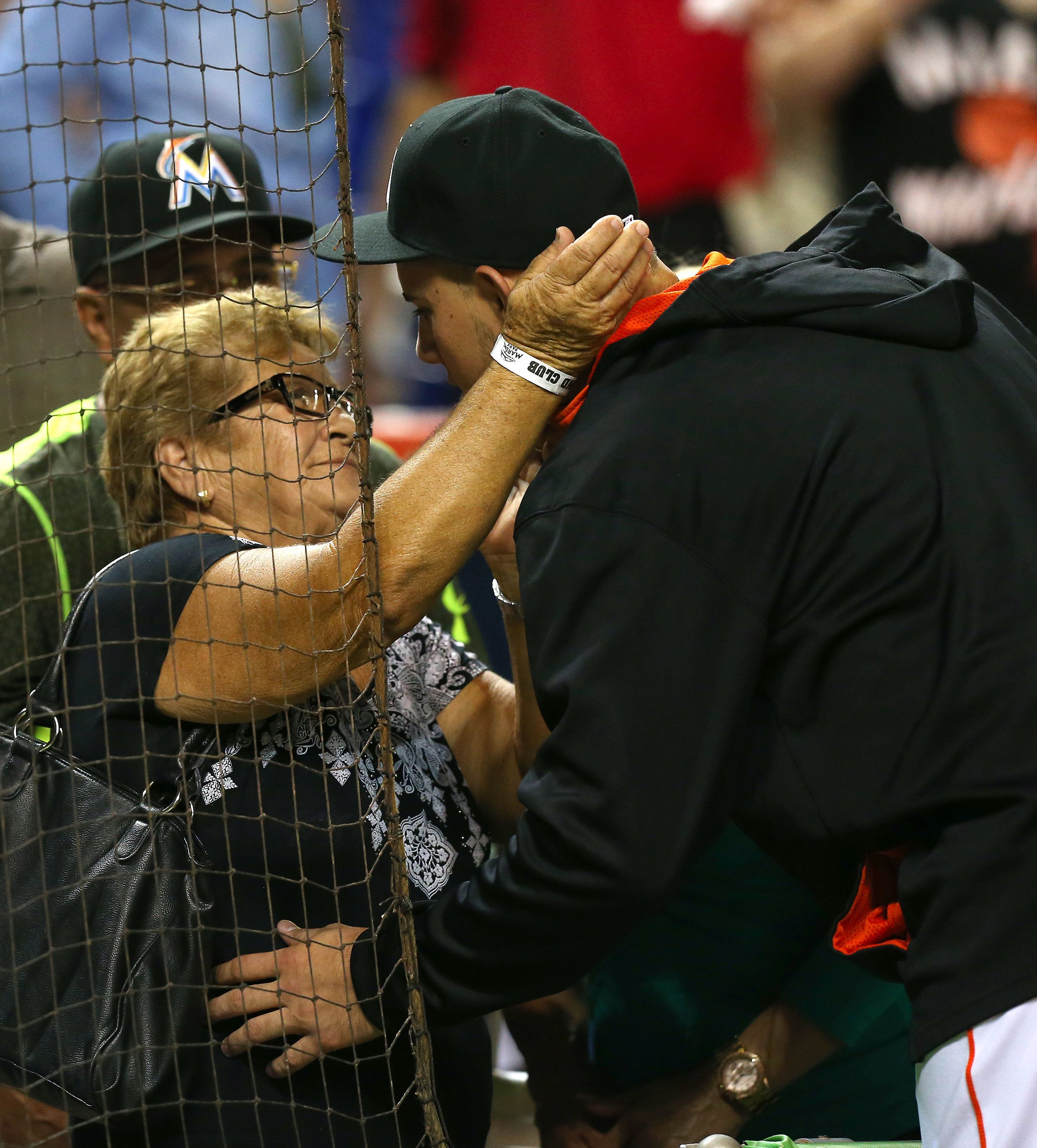 The Cuban-born pitcher is seen embracing his grandmother, Olga, following a 2-0 win against the Cincinnati Reds in July 2015.