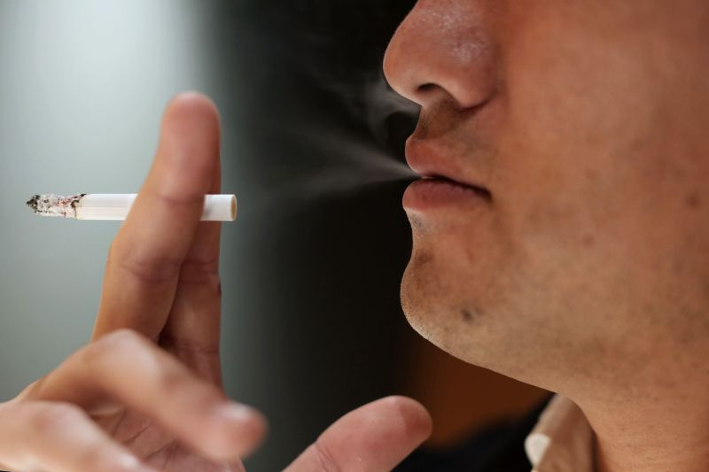 An estimated 18 percent of Japanese adults smoke, according to the World Health Organization.