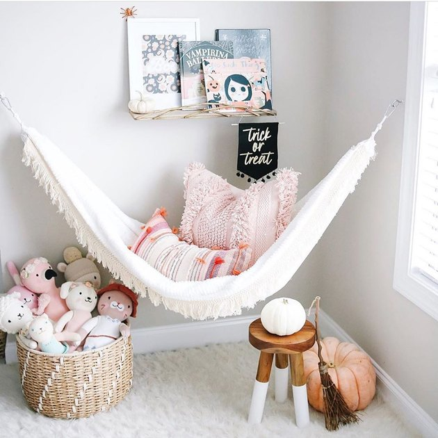 bohemian kids bedroom idea with a hammock hanging in reading nook