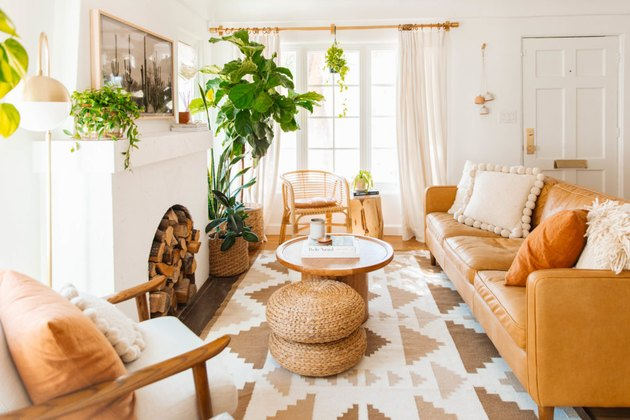 Midcentury modern bohemian living room in neutral colors and natural furniture