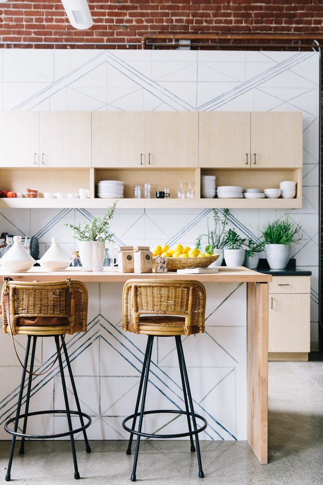 patterned bohemian kitchen with rattan chairs
