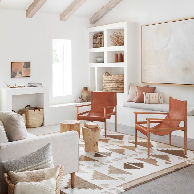 desert modern living room with leather chairs and woven baskets