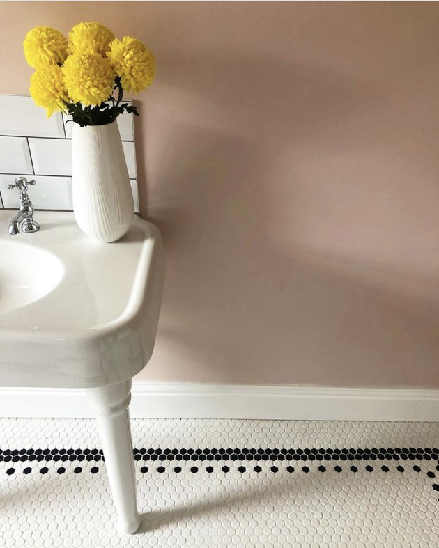 dusty rose neutral colors in bathroom with penny floor tile
