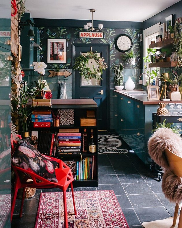 maximalist kitchen with botanical wallpaper and green cabinets