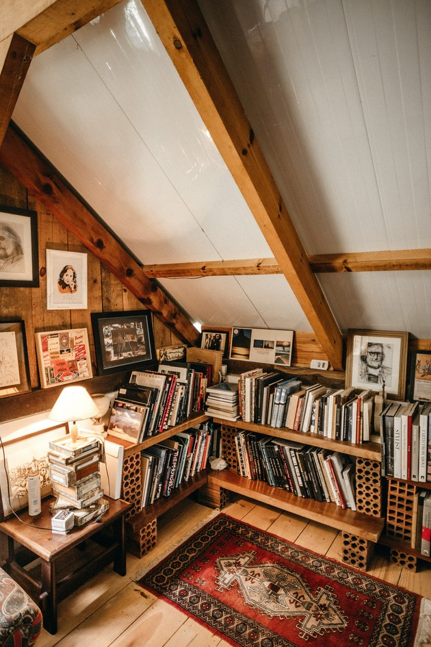 Rustic wooden small attic ideas for space converted into a book den.
