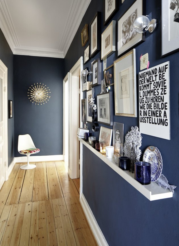picture ledge in hallway below gallery wall