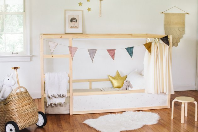boho girls room with pennant flag, neutral space