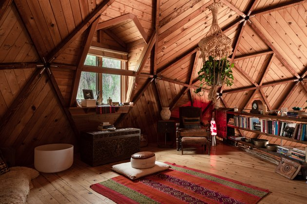 attic living room with knotty pine ceiling