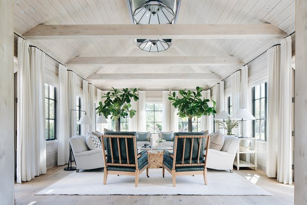 white farmhouse family room idea with wooden beams