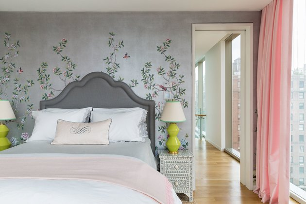 Feminine/romantic bedroom with upholstered headboard and floral wallpaper