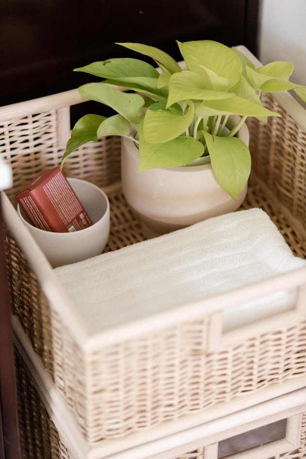 Basket with white towels and plant