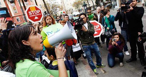 "Members of the Mortgage Victims' Platform attend an ""escrache"" (denunciation) protest near the house of Popular Party congressman Ignacio Gil Lazaro in Valencia"