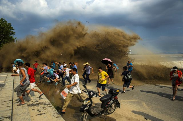 Spectators Get Washed Away by Typhoon Trami