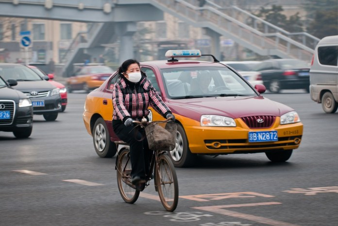 china to lessen pollutionreplacing taxis with electric cars