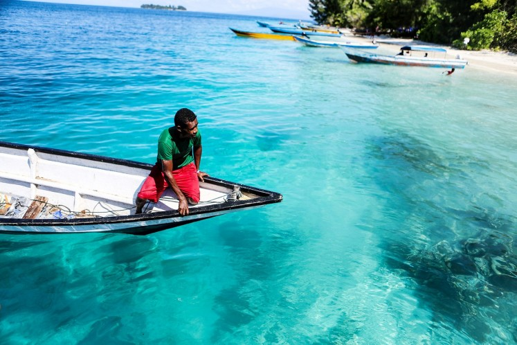 See-through sea: A fisherman tries to reach the shore of one of the Fam Islands.