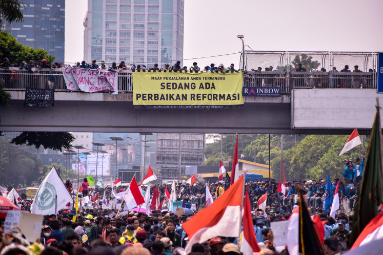 Students protest against the planned revisions to the Criminal Code and the revision of the Corruption Eradication Commission Law in front of the House of Representatives in Senayan, Jakarta, on Sept. 24, the biggest student movement since 1998.