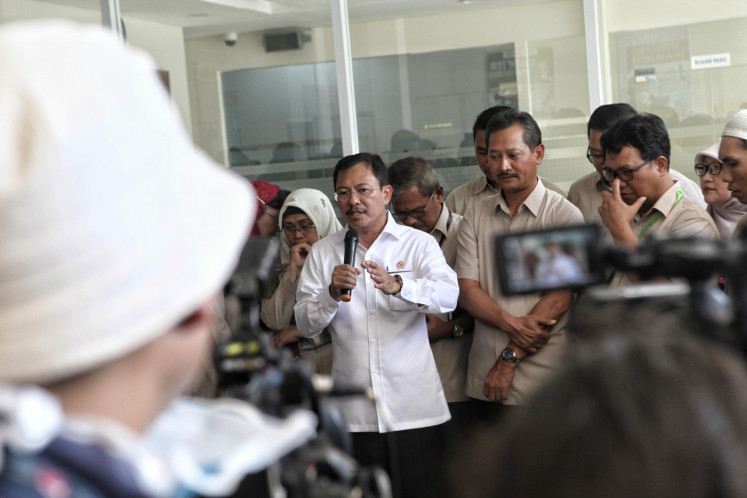 Health Minister Terawan Agus Putranto speaks to the press at the isolation building of the Sulianti Saroso Hospital (RSPI Sulianti Suroso) in Jakarta on Monday 2 March 2020. The Minister of Health stated that two Indonesian citizens were positively affected by the corona virus and who were currently in the isolation room of the RSPI Sulianti Saroso.