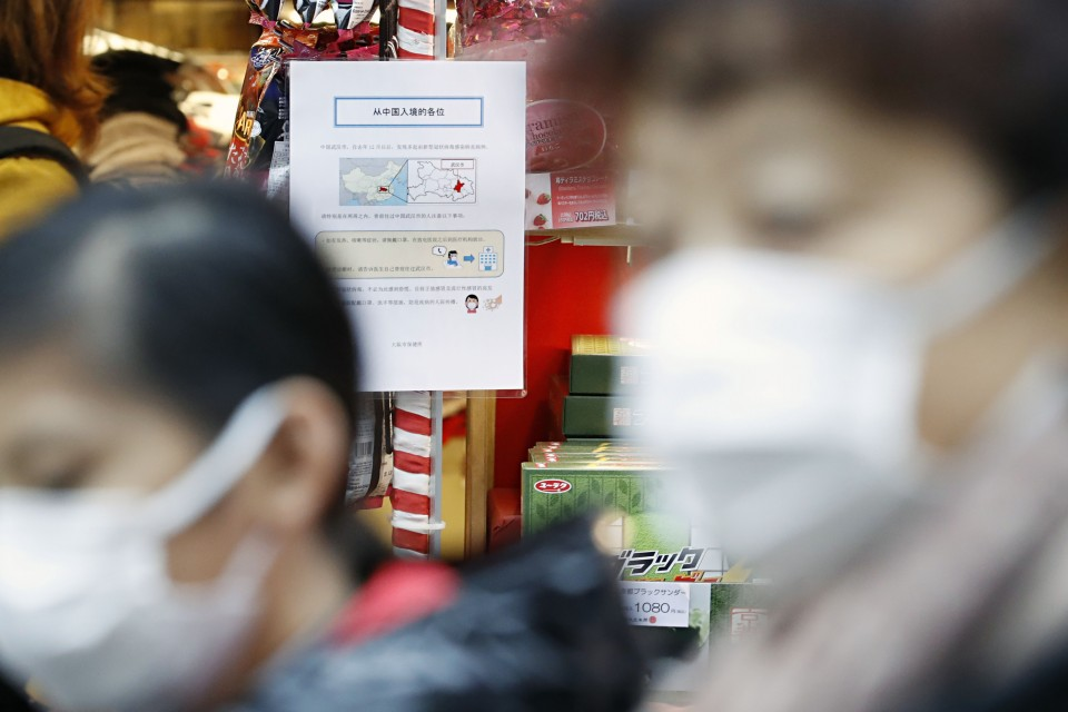 Japan confirms 2nd new virus case, braces for Chinese tourist influx