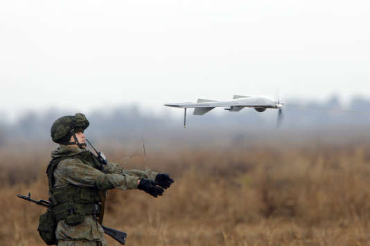 A Russian soldier launches a drone during a Russian, Belarusian and Serbian military exercise entitled