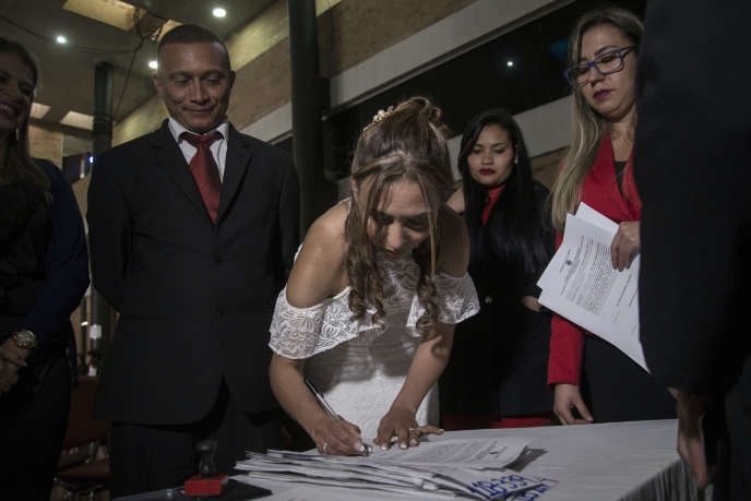 """Celebrating marriages between former FARC members and paramilitary groups in Bogotá in September 2018. These """"marriages for peace"""" are an initiative of the Colombian Agency for the Reintegration of Ex-Combatants."""