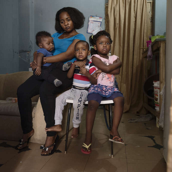 """Angelica Nsoso and her children Kissalu, Felipe and Jeouany in their occupation apartment """"9 de Julho"""" in Sao Paulo, Brazil."""