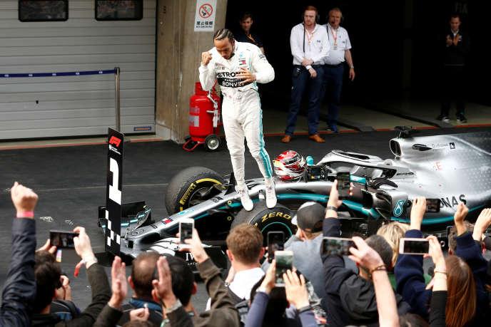 Lewis Hamilton celebrates his victory in Shanghai.