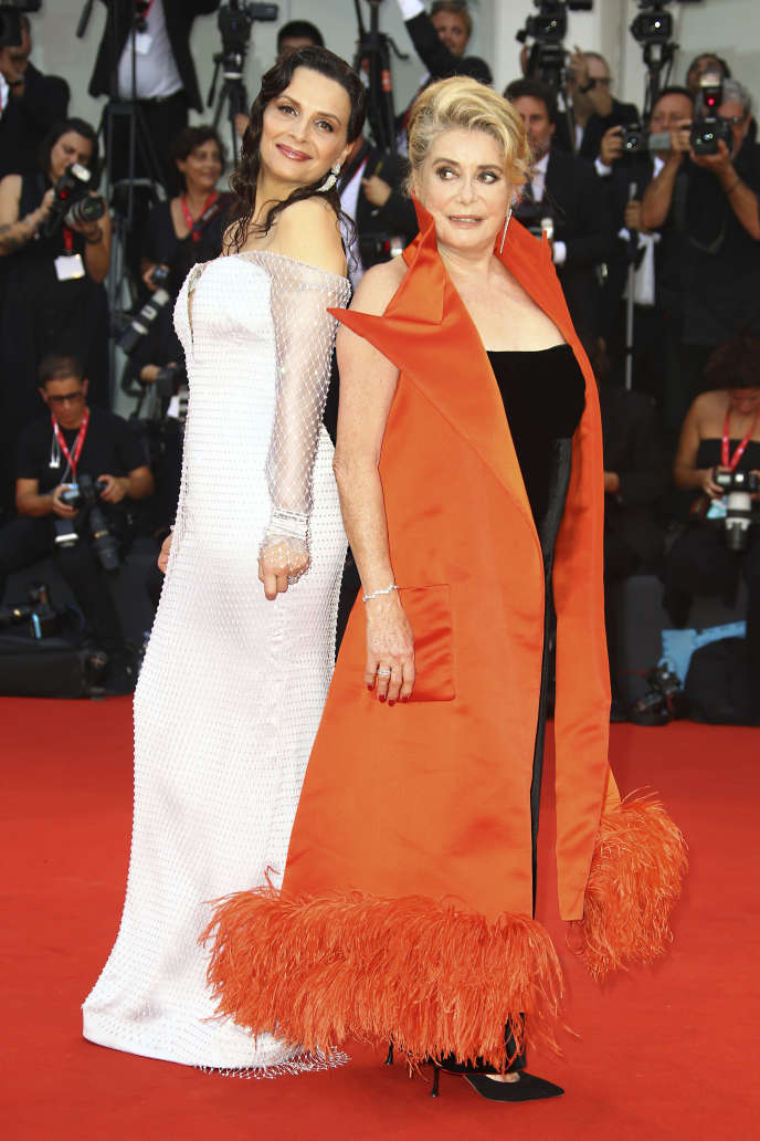 Juliette Binoche and Catherine Deneuve at the opening ceremony of the Mostra, Wednesday, August 28.