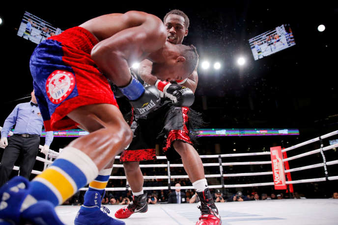 Charles Conwell (black shorts) and Patrick Day (red shorts) during their fight at the Wintrust Arena in Chicago on October 12th.