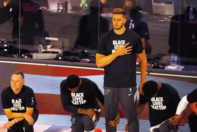 Miami Heat player Meyers Leonard remained standing during the American anthem in Orlando, Fla., On August 1.