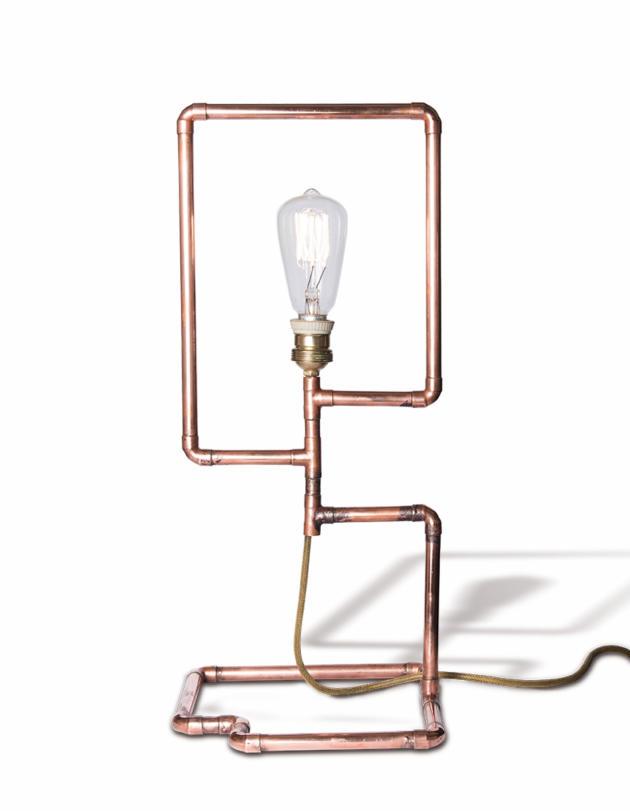 Lampe du designer Ousmane MBaye, tubes en cuivre et douille en porcelaine(2015).