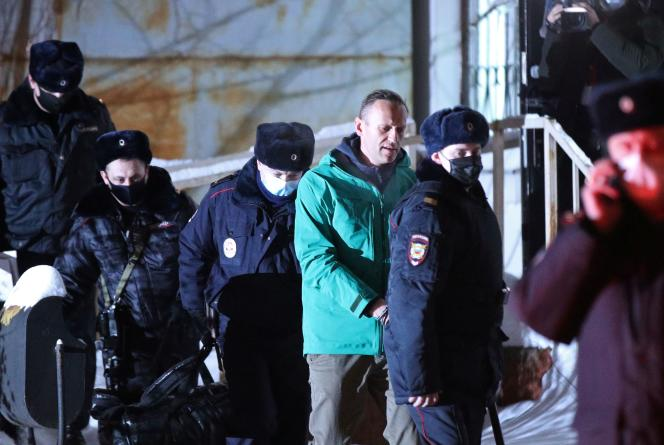Russian opponent Alexei Navalny escorted by police after a hearing in Khimki, near Moscow, on January 18.