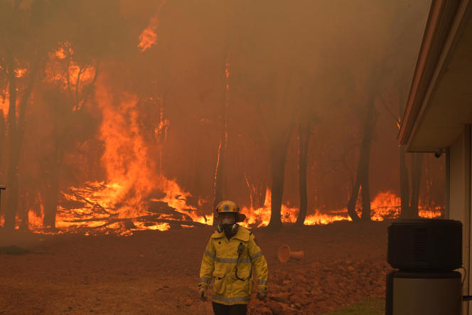 The blaze, which burns northeast of the Australian west coast city of Perth, has destroyed dozens of homes.