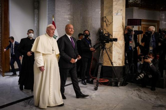 Pope Francis (left) with Iraqi President Barham Saleh at the Presidential Palace in Baghdad on March 5, 2021.