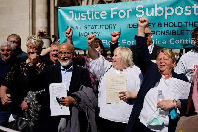 Former UK post office managers celebrate London Court of Justice ruling clearing them on April 23.