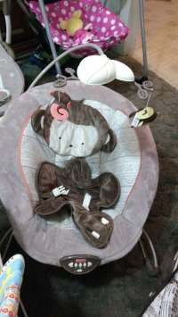 letgo - brown and gray Monkey bouncer seat in Welby, CO