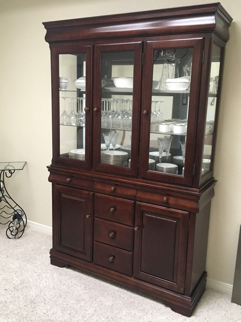 Used Cherry china cabinet in El Paso