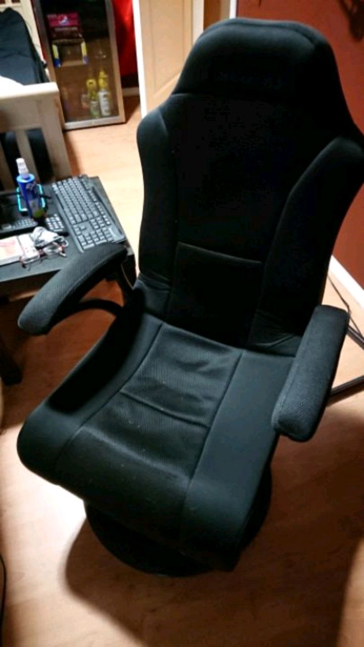 office chair kelowna toddler table chairs used black leather padded rolling arm for sale in gaming
