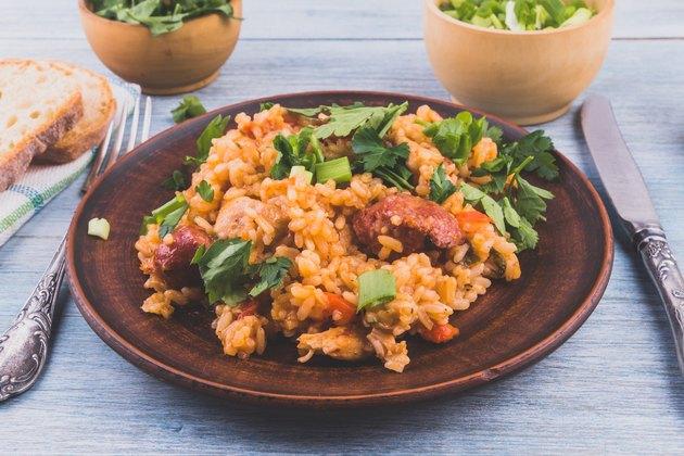Jambalaya rice chicken and smoked sausage on rustic wooden background