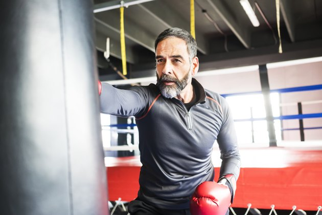 A man with prostate cancer exercising at the gym by boxing