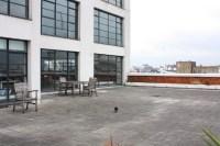 Large balcony of open plan, modern loft-style apartment ...