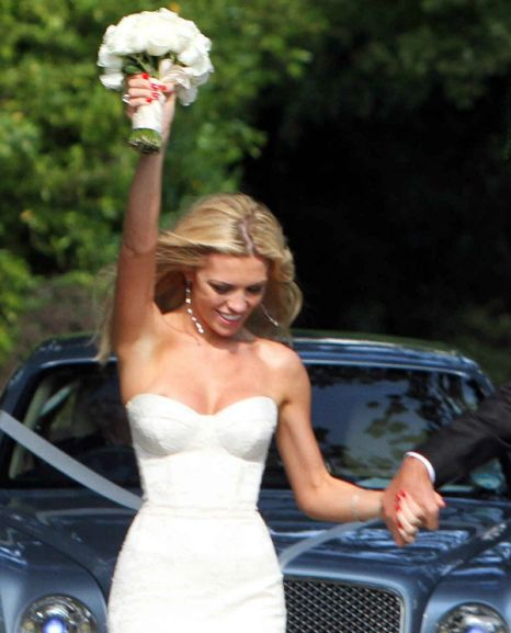 Abbey Clancy makes wedding dress boob to leave Peter