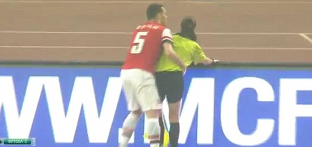 Thomas Vermaelen grabs Sian Massey during Arsenal friendly