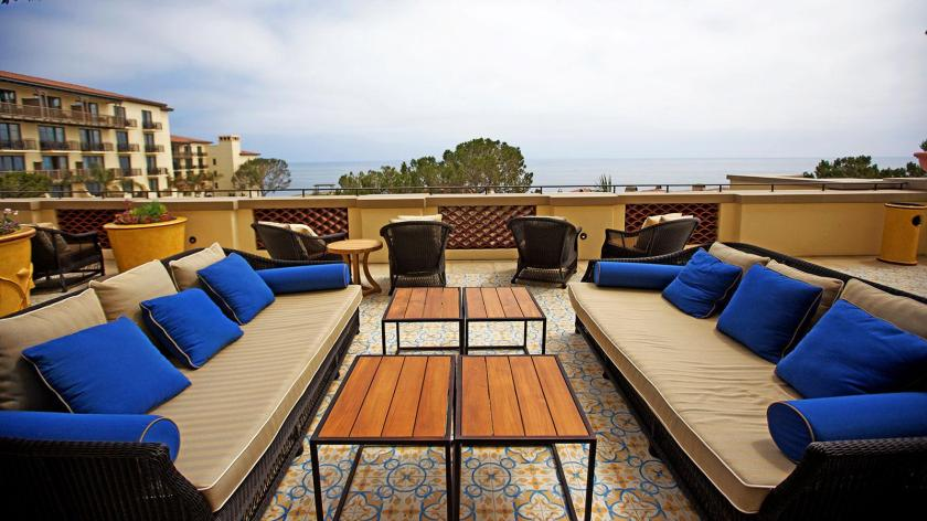 The Spanish-tiled terrace, where cigars are enjoyed, overlooks the Pacific Ocean.