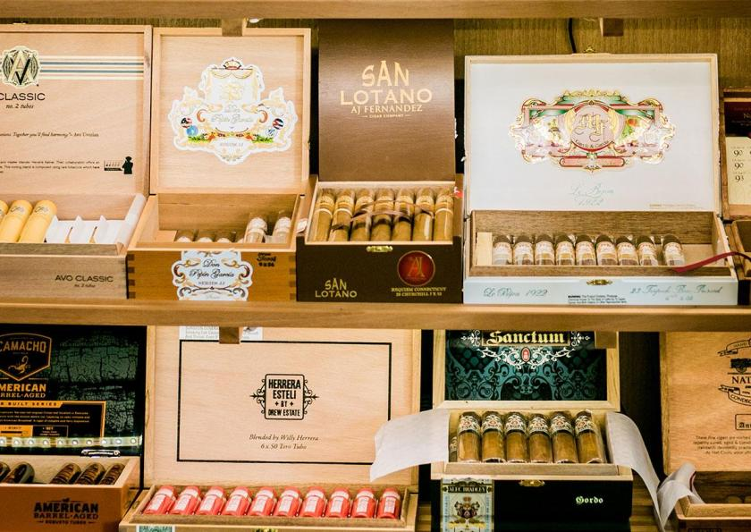 The cigar selection includes offerings from Avo, My Father, AJ Fernandez, Camacho, Drew Estate, and Alec Bradley, among others.