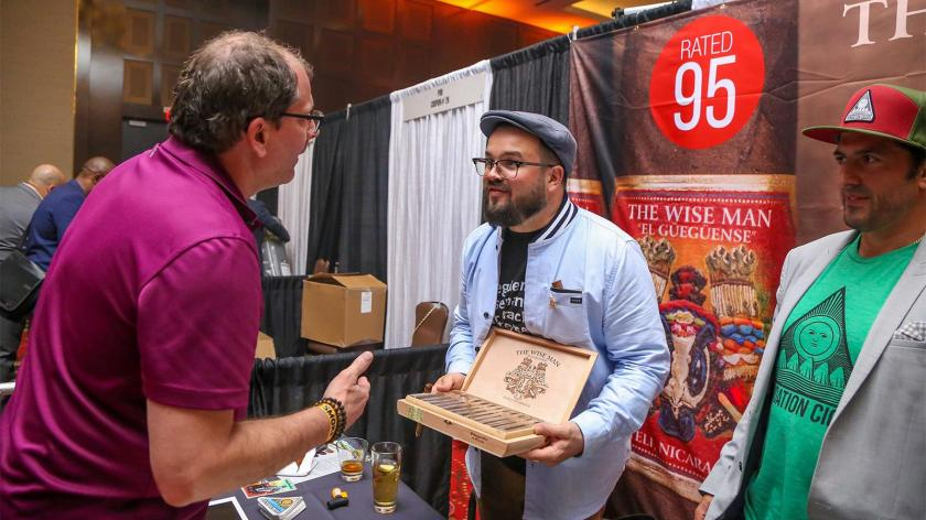 Foundation Cigars owner Nick Melillo talks with a guest at his booth.