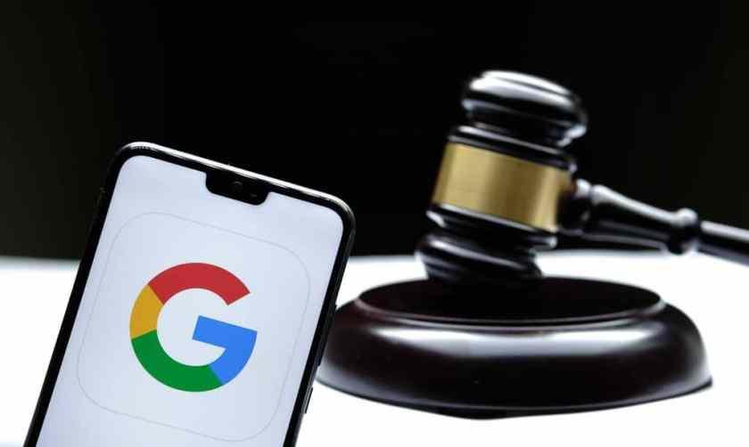 Google logo displayed on smartphone next to court hammer