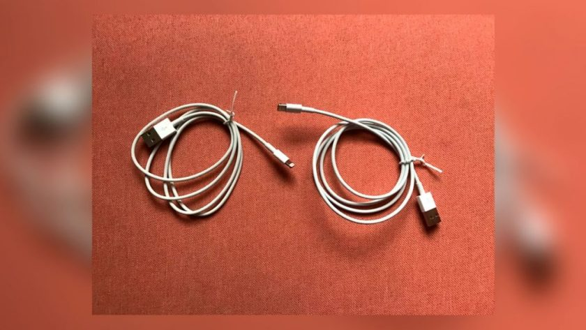 two USB cables rolled up next to each other under a rug, only one of which steals passwords